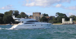 Brownsea Castle and motorboat